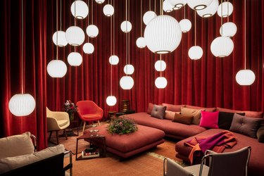 room with furniture and hanging lights