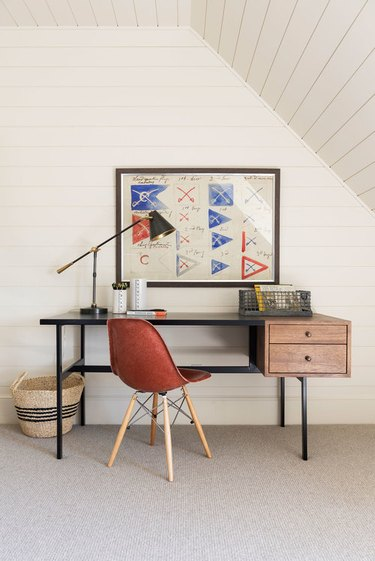 attic playroom with homework desk and red chair