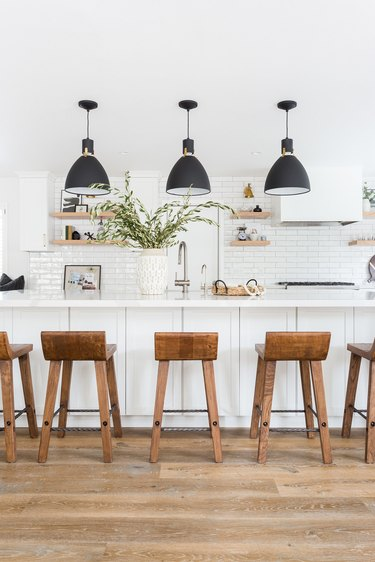 Farmhouse kitchen lighting with black pendant lights over island