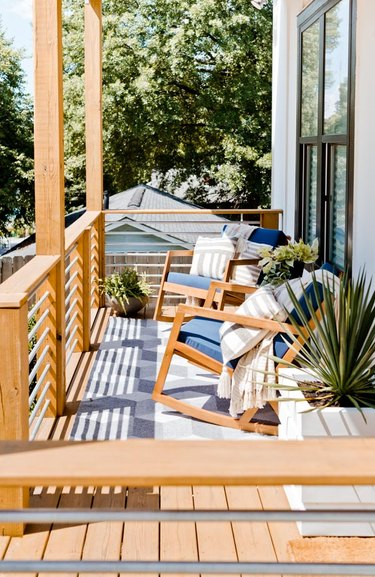 Front porch before and after with blue rocking chairs and plants