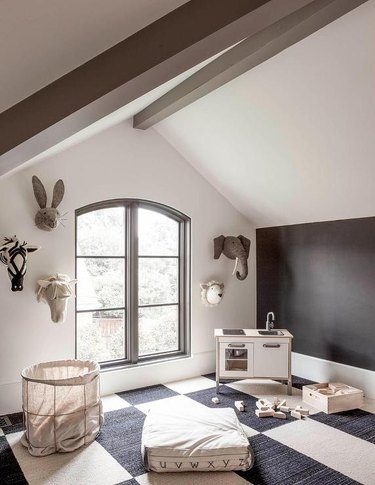 Attic playroom with felt animal heads decor and mini kitchen