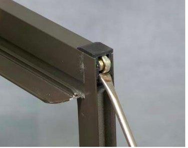 Closeup of sliding window roller.