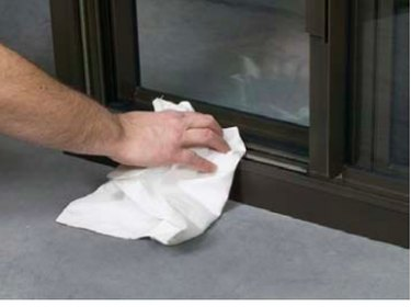 Cleaning a window frame.