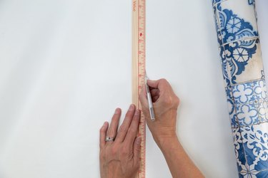 cutting removable wallpaper for stair risers