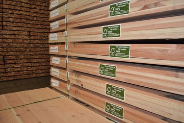 Lumber in a retail store with the FSC logo.