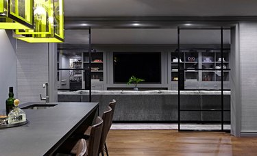 painted basement ceiling in dark gray with lime green lamps