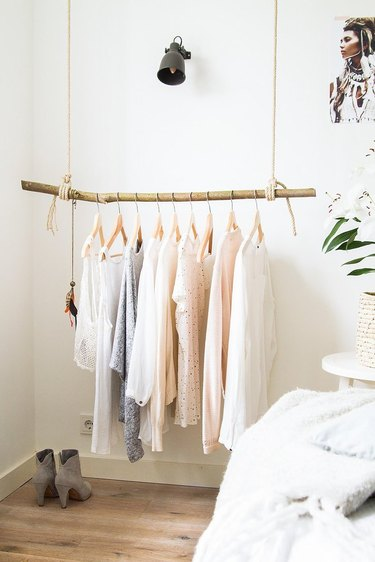 attic storage with hanging clothes rail