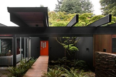 black midcentury modern exteriors with red doors