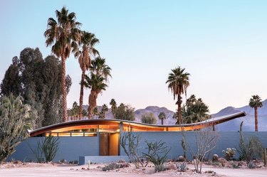 blue midcentury modern exteriors on wave house