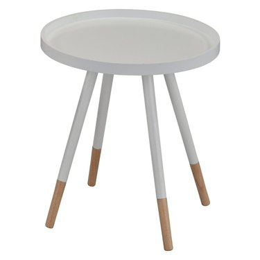 Small white round mid-century side table with four legs, the bottom third of which are natural wood-colored