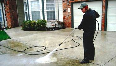 Power washing a driveway.