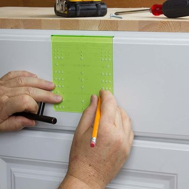 Cabinet hardware template.