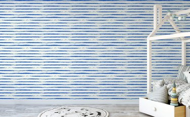 blue and white stripe coastal wallpaper in kids bedroom