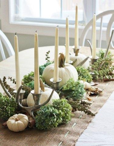 fall flower arrangement with white pumpkins, burlap runner and candlesticks