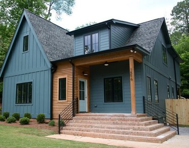 teal blue home exterior with wood trim and brick steps