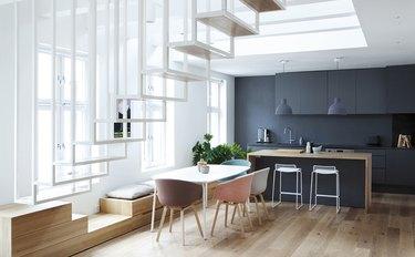 unexpected kitchen storage idea hidden below dining bench seating