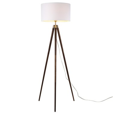 Tripod mid-century floor lamp with white shade and wooden legs