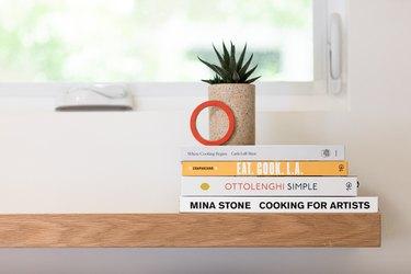 Cookbooks on an open shelf
