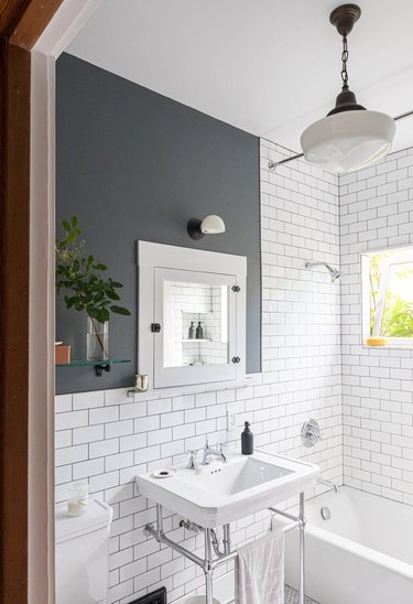 vintage bathroom lighting idea with milk glass pendant light