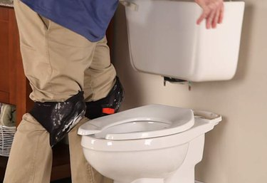 Disassembling a toilet.