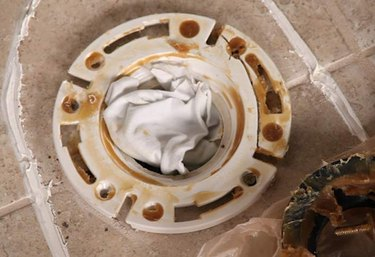 Toilet flange blocked with a rag.