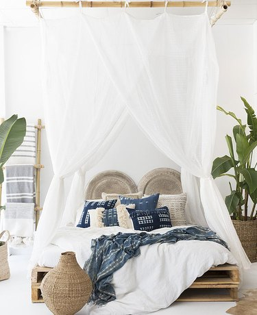 tropical bedroom with white canopy