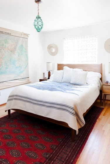 The master bedroom, with vintage furniture and light fixture.
