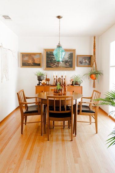 The dining area with three paintings that once hung in Steph's grandfather's home.