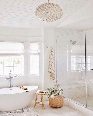 minimal bohemian bathroom lighting idea with capiz shell chandelier