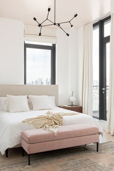 Bedroom with blush pink ottoman