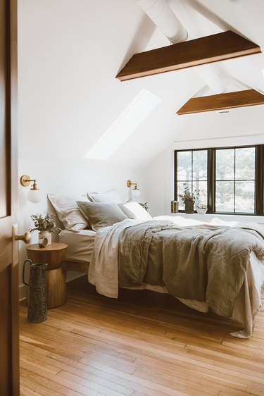 Attic Bedroom Furniture with wood beams and window