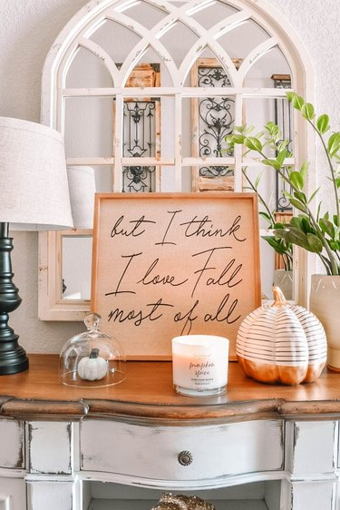Fall decor idea with sign with white mirror and pumpkins