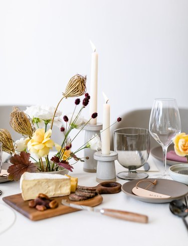 Minimalist fall centerpiece with dried florals alongside cheeseboard
