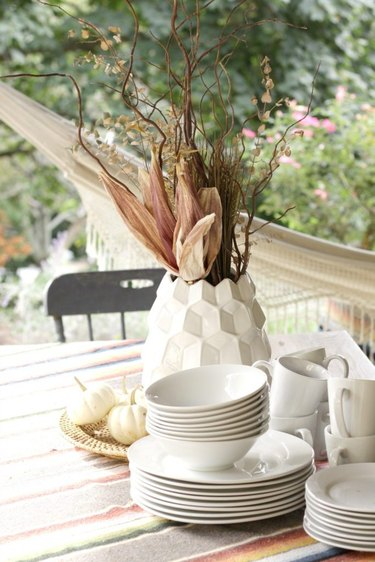Modern fall centerpiece in white geometric vase with dried fall florals
