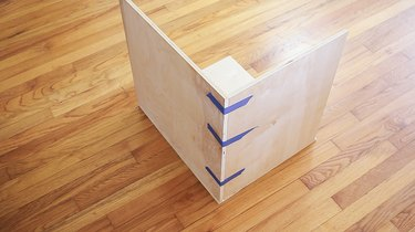 Taping the corners of plywood pieces together