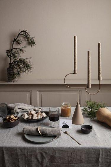 Candelabra fall centerpiece in modern,  neutral dining room