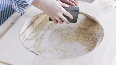 Sanding the round hole cut out of front piece