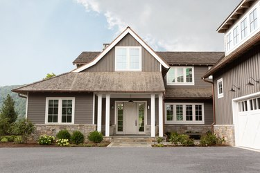 How to Choose Exterior House Colors on taupe house with white window trim and wide driveway