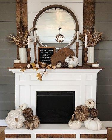 earth-toned hearth display featuring farmhouse fall decor