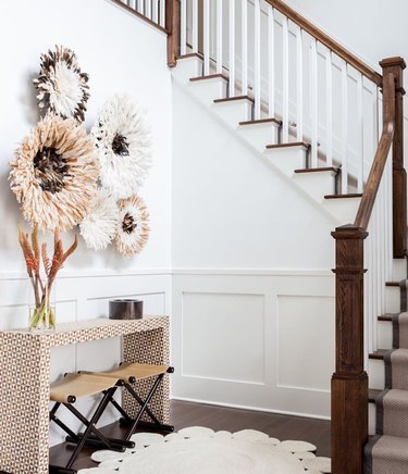 entry with juju hats, inlaid console table, and farmhouse fall decor
