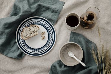 dining table with Cultiver linens and ceramic dishware