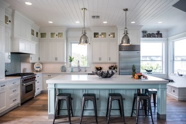 Coastal kitchen ideas with blue island and white cabinets