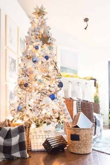 white and blue flocked coastal Christmas tree