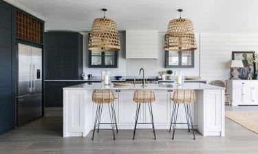Modern coastal kitchen ideas with basket lights over island