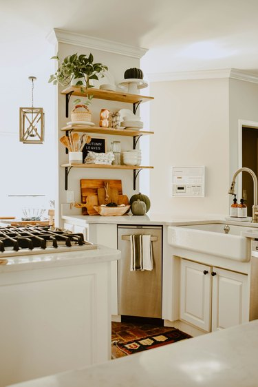 fall kitchen decor in white kitchen with open shelving