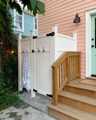 Green and pink exterior beach house colors with outdoor shower