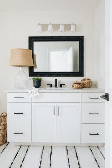 Striped tile coastal flooring idea in bathroom with white vanity
