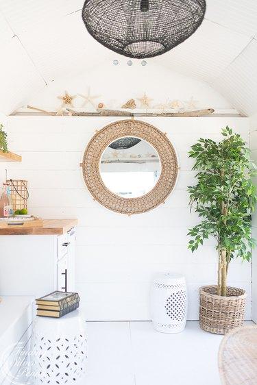 Painted white hardwood coastal flooring idea in pool house with coastal decor