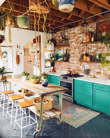 Bohemian kitchen style with houseplants and turquoise cabinets