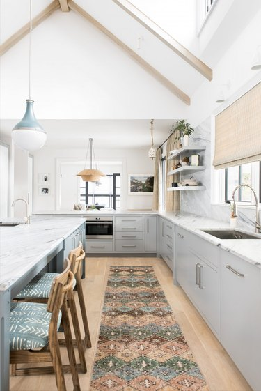 Modern kitchen style with patterned rug and sleek lights